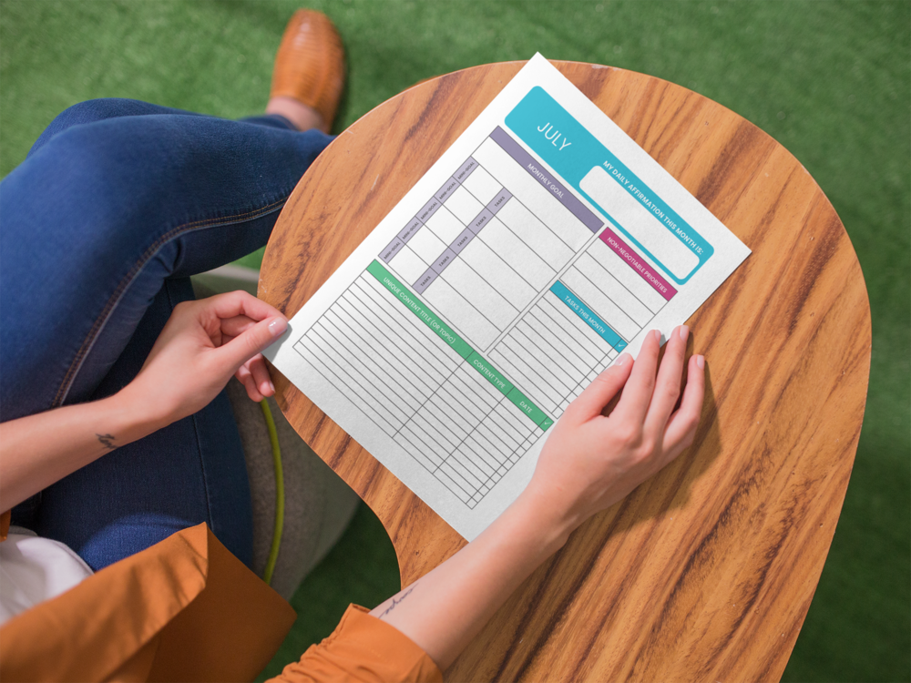 Woman Holding Monthly Dashboard printout
