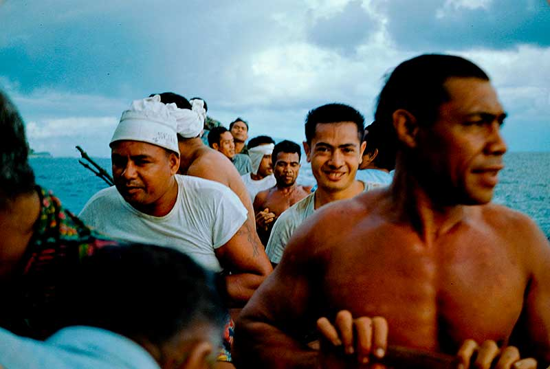 Bringing food to a big house for a meal for the chiefs and young men. Some of the food will be brought back to the men's families. Photo of Ofu Villagers in Manu'a Samoa 1955. By Melvin Ember HRAF President (1987-2009)