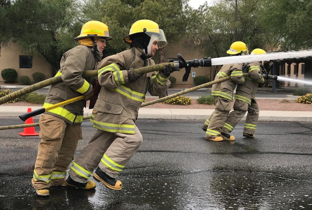 fire service students spraying water